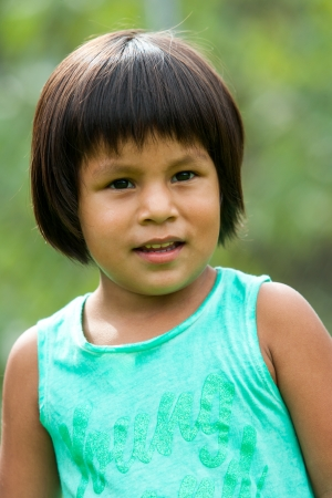native american baby: Close up portrait of cute south american girl outdoors. Stock Photo