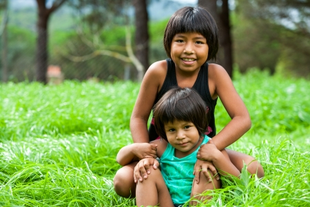 native american: Portrait of two latin american sisters outdoors.