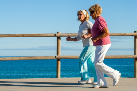 Action portrait of elderly women jogging together outdoors. Stock Photo - 23712772