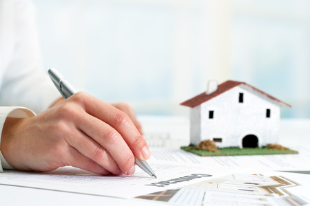 solicitor: Extreme close up of female hand signing real estate contract. Stock Photo