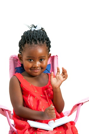 Portrait of sweet african girl with note book waving hand.Isolated on white background. photo