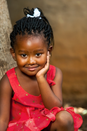 Close up facial portrait of cute african girl outdoors.