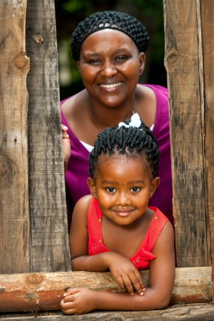 african american ethnicity: Close up family portrait of african mother with daughter outdoors.