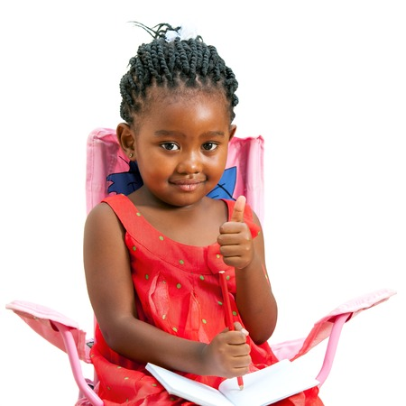 Portrait of african youngster with note book doing thumbs up.Isolated on white background. photo
