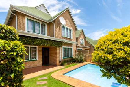 Two story family home with private swimming pool. photo