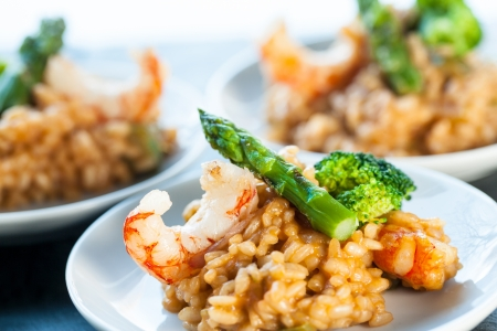 seafood risotto rice with shrimps and green asparagus. Stock Photo