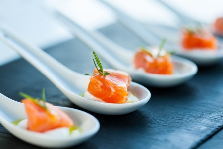 Extreme close up of smoked salmon morsel catering. Stock Photo