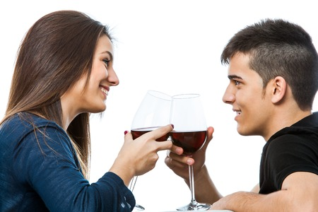 Close up portrait of cute couple drinking a glass of red wine together.Isolated on white background. photo