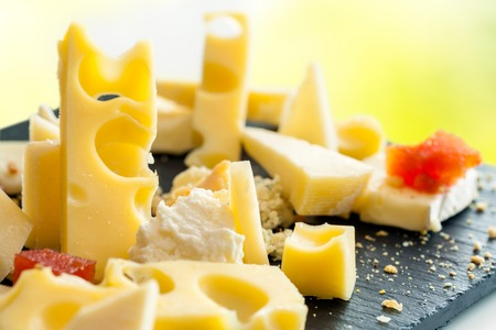 emmental: Extreme Close up of appetizing cheese assortment.