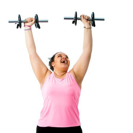 mujer gorda: Retrato de la señora corpulenta que hace entrenamiento de peso.