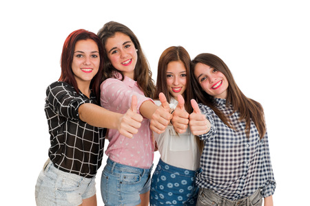 contentedness: Portrait of Teen girls doing thumbs up.Isolated on white background. Stock Photo