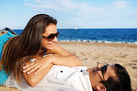 Portrait of handsome young Couple spending time on beach photo