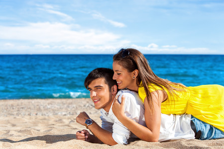 Portrait of cute Teen Couple spending time together on summer holiday. photo