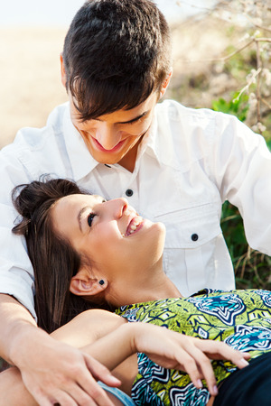 Close up of Teen couple sharing intimate moment outdoors. photo