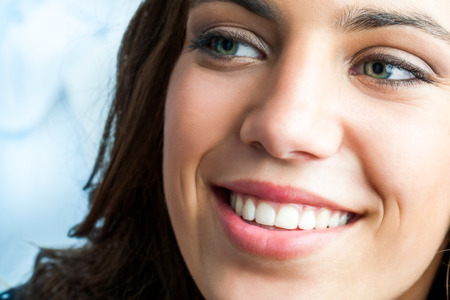 looking aside: Close up beauty portrait of girl with charming smile looking aside. Stock Photo