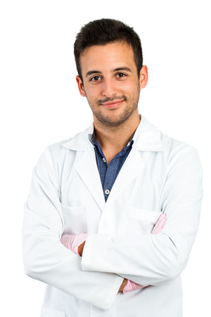 Close up portrait of young male doctor isolated on white background. photo