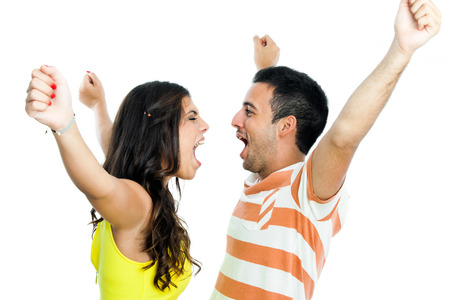 Young couple with arms raised shouting at each other.Isolated on white background. photo