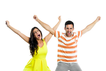 Close up portrait of couple shouting with arms raised.isolated on white background. photo