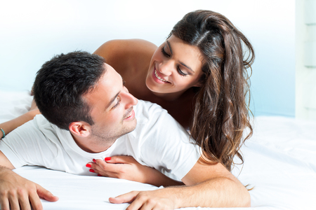 romantic couples: Portrait of handsome Young couple sharing intimacy in bedroom.