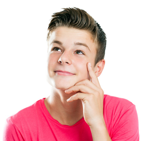 Close up portrait of Handsome teen boy looking at corner isolated.