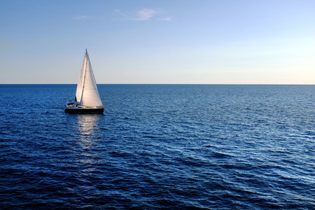 sailing yacht: Yacht with reflection sailing on open sea.
