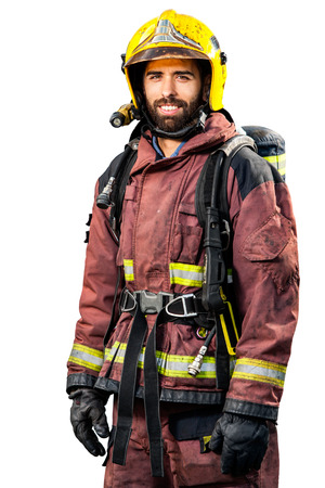Fireman in fire fighting gear isolated on white background. Stockfoto