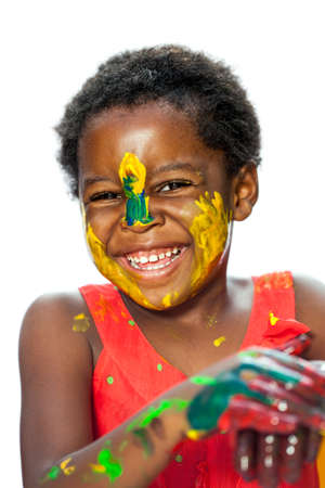 female hand: Close up portrait of happy African youngster with painted face.Isolated against white background.
