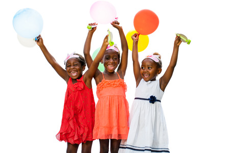 raising hands: Close up portrait of three African youngsters raising hands having fun with balloons at party.Isolated on white background.