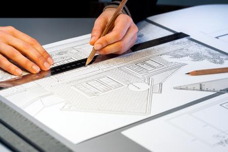 quantity surveyor: Macro close up of quantity surveyor working on architectural layout. Stock Photo