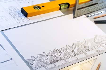 Close up of architectural design plans with measuring objects. Stock Photo