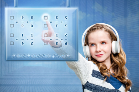 futuristic girl: Close up portrait of young female student solving mathematical problem on futuristic digital screen. Conceptual portrait of girl touching screen against blue background.