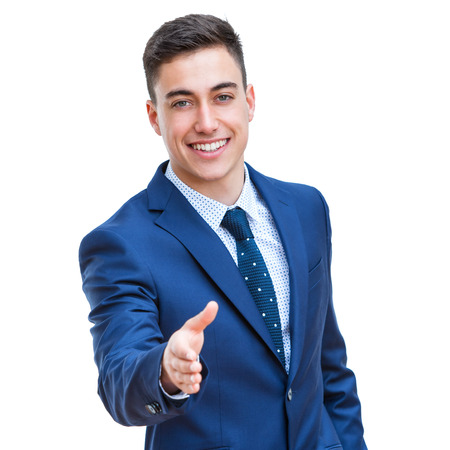 Close up portrait of young Businessman stretching out hand. Isolated on white background. Stock Photo