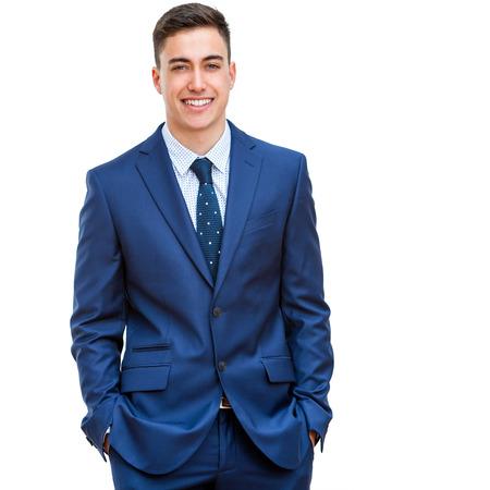 파란색 양복에 매력적인 젊은 사업가의 초상화를 닫습니다. 절반 본문 세로 흰색 배경에 고립. 스톡 콘텐츠