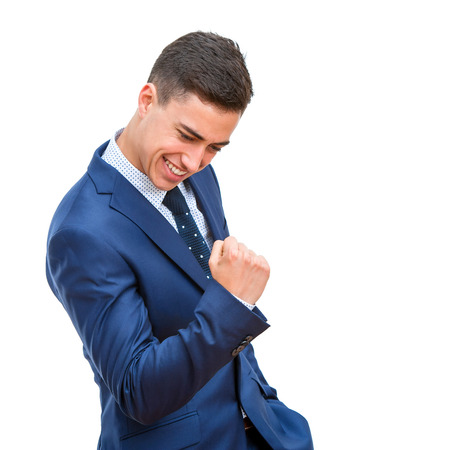 expression: Close up portrait Successful businessman pulling a fist. Young business student with victorious facial expression Isolated on white background.