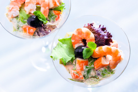 seafood salad: Extreme close up of seafood cocktail starter. Two glasses filled with langoustine and crab stic salad viewed from top.