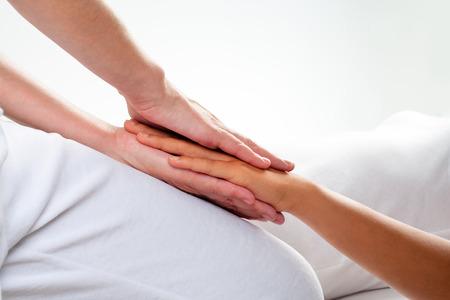 manipulation: Close up of chiropractor doing reiki treatment on girls hand. Stock Photo