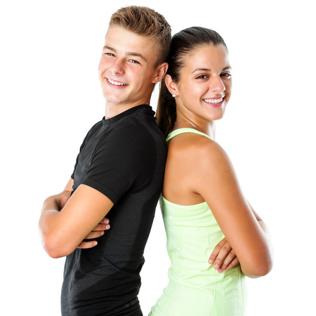 Close up portrait of attractive teen couple in sportswear standing back to back.Isolated on white background. Stok Fotoğraf