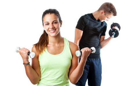 lifting: Close up portrait of attractive teen girl doing aerobic workout with boy in background. Isolated on white background.