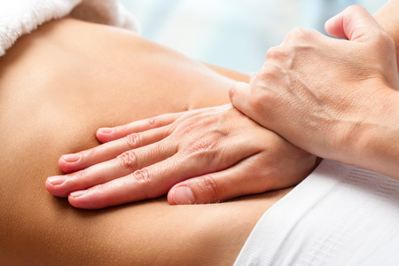 manipulation: Macro close up of Osteopathic belly massage. Stock Photo
