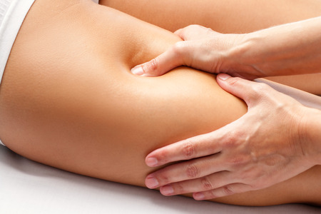 chiropractic: Macro close up of Physiotherapist hands massaging hamstring on female athlete. Stock Photo