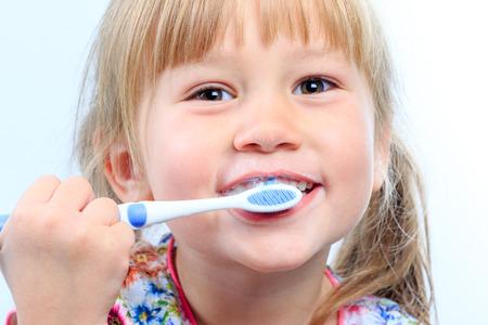 face shot: Macro close up Face shot of infant brushing teeth.
