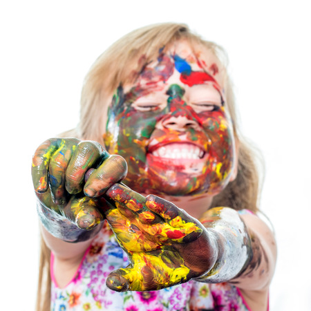 messed: Close up portrait of little girl messed with color paint.Infant with comical behavior.Isolated on white background. Stock Photo