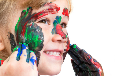 face shot: Macro Close up Face shot of little girl painting face with color paint.Isolated on white background.
