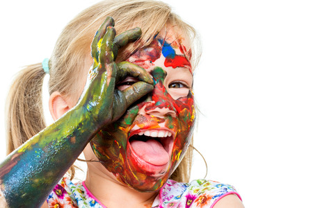 face shot: Close up portrait of little girl covered with color paint and open mouth. Face shot of infant doing okay sigh in front of eye.Isolated on white background.