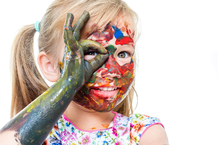 messed: Close up portrait of Little girl messed with color paint. Infant doing okay sign in front of eye.Isolated on white background.