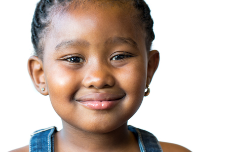face shot: Close up face shot of cute little african kid isolated on white background. Stock Photo