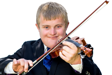 disadvantaged: Close up portrait of young man with down syndrome playing violin. Handicapped musician wearing suit isolated against white background.