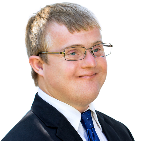 face shot: Close up face shot of young businessman with down syndrome. Handicapped man in suit isolated against white background.