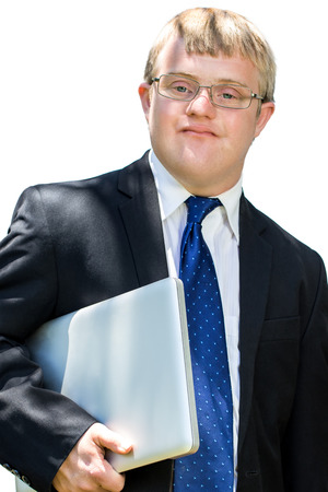 disadvantaged: Close up portrait of businessman with down syndrome holding laptop. Isolated on white background.