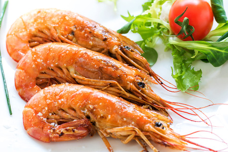 mouthwatering: Extreme close up of mouthwatering fresh grilled king prawns. Stock Photo